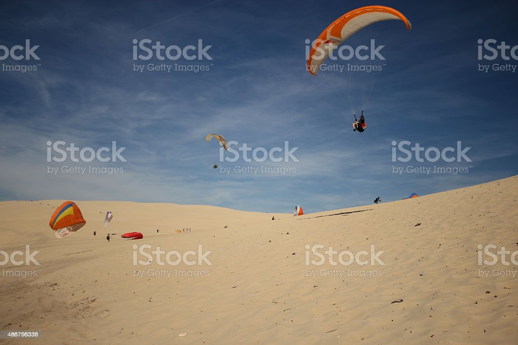 Paragliding over the Dune of Pilat with sky as background stock photo