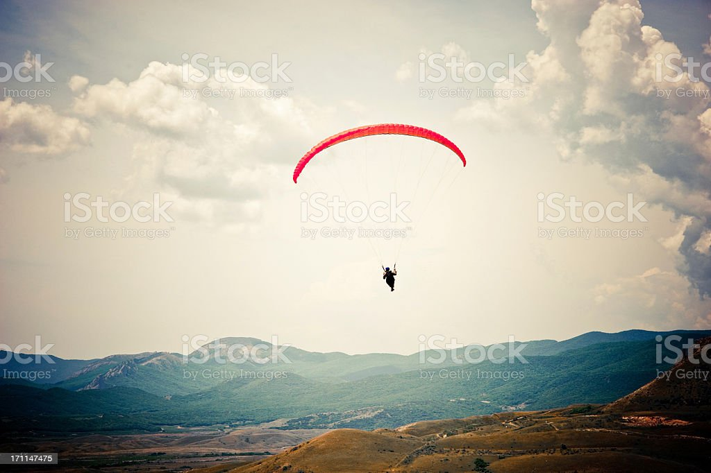 paragliding over the rock stock photo