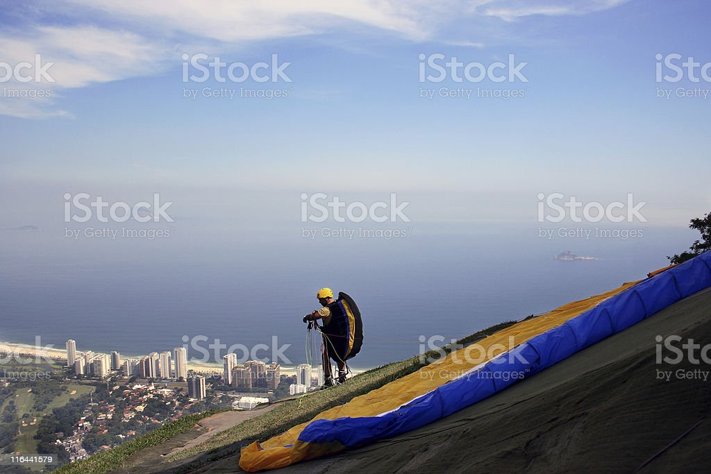 Paragliding pilot minutes before the takeoff stock photo