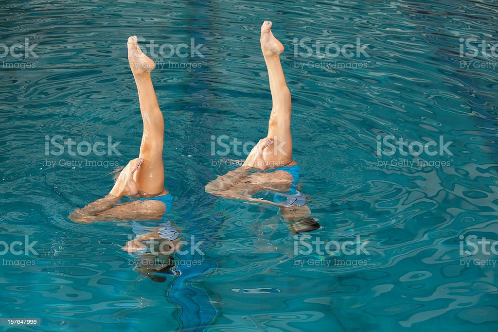 parallel legs of synchronized swimming girls stock photo