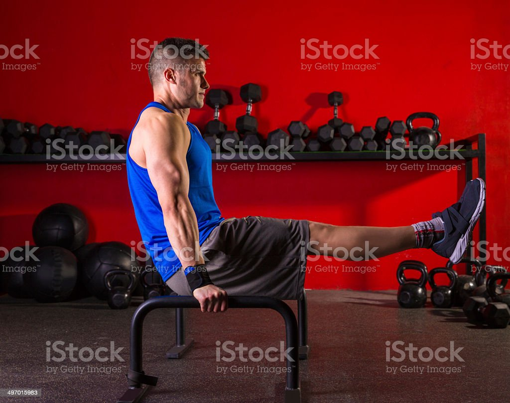 Parallettes man parallel bars workout at gym stock photo