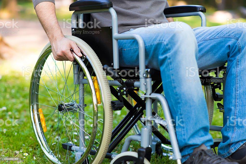 Paralyzed man using his wheelchair stock photo