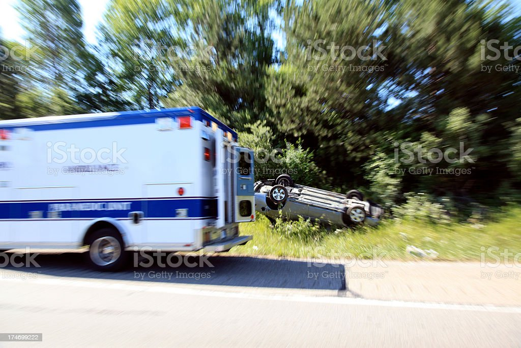 Paramedic and Car Flipped Onto its Roof After Crash Accident royalty-free stock photo