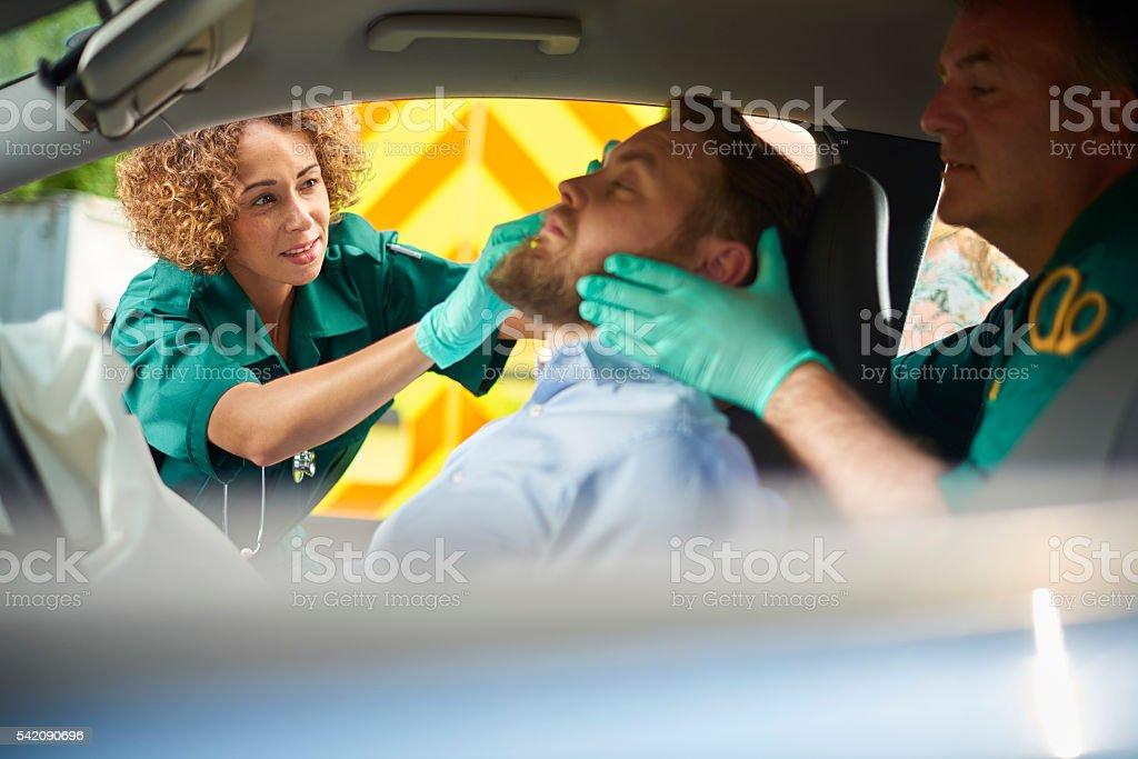 paramedic at the scene of a car crash stock photo