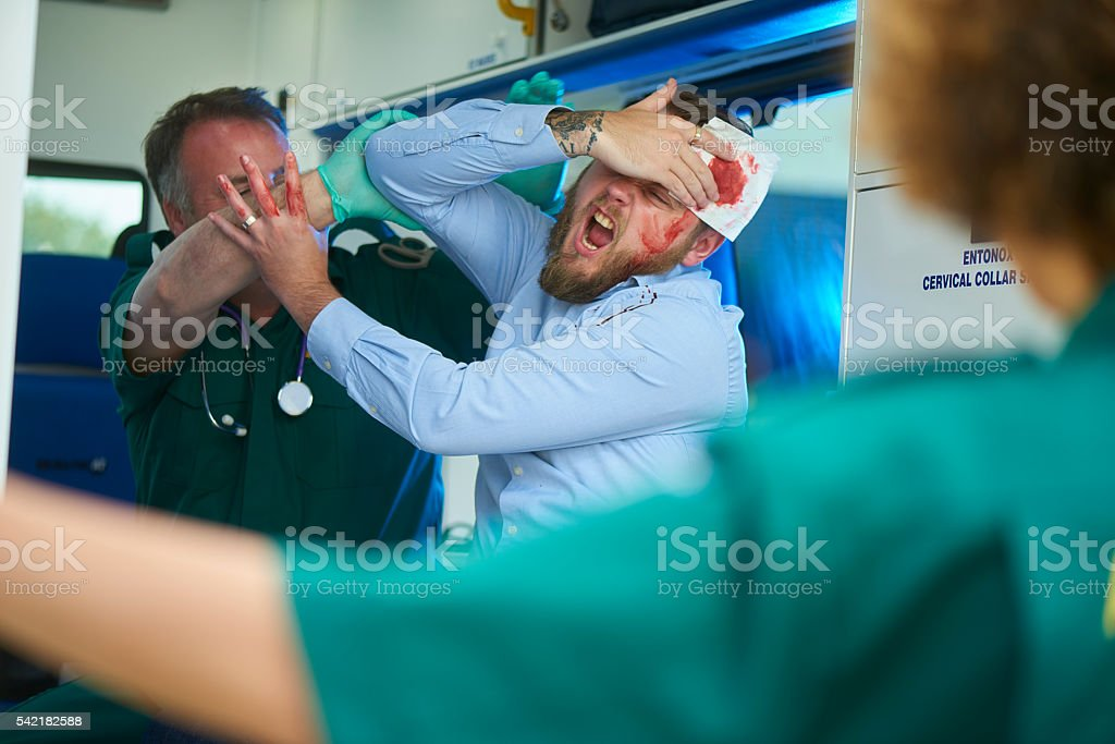 paramedic dealing with abusive patient stock photo
