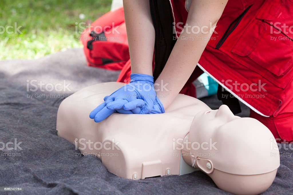 Paramedic demonstrate Cardiopulmonary resuscitation (CPR) on dummy stock photo