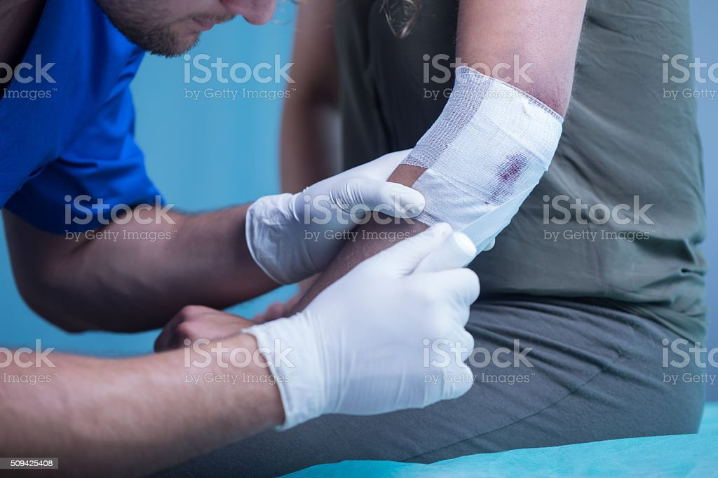 Paramedic dressing wound stock photo