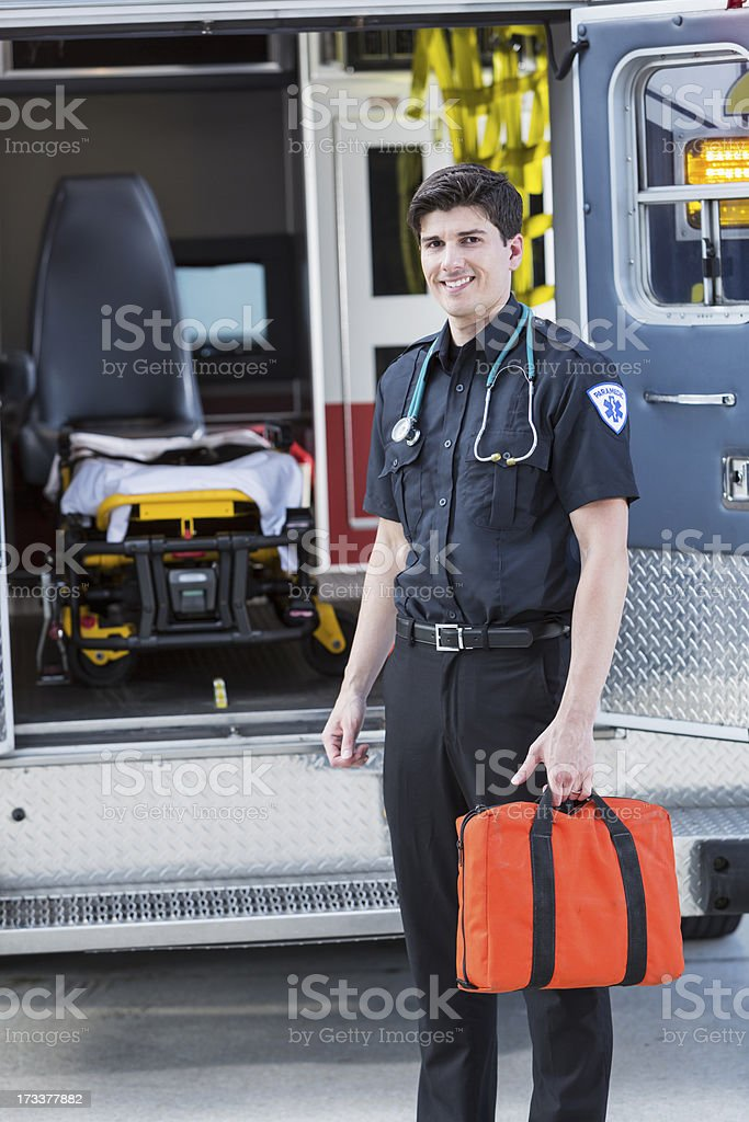 Paramedic standing by ambulance royalty-free stock photo