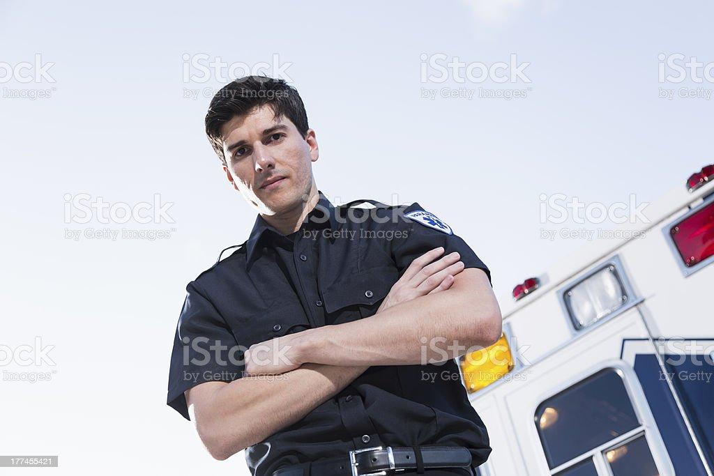 Paramedic standing by ambulance royalty-free stock photo