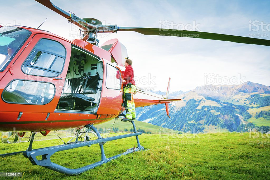 paramedic standing by his helicopter royalty-free stock photo