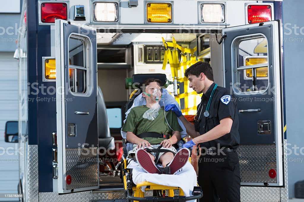 Paramedic with child on stretcher royalty-free stock photo