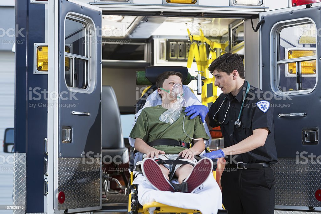Paramedic with child on stretcher stock photo