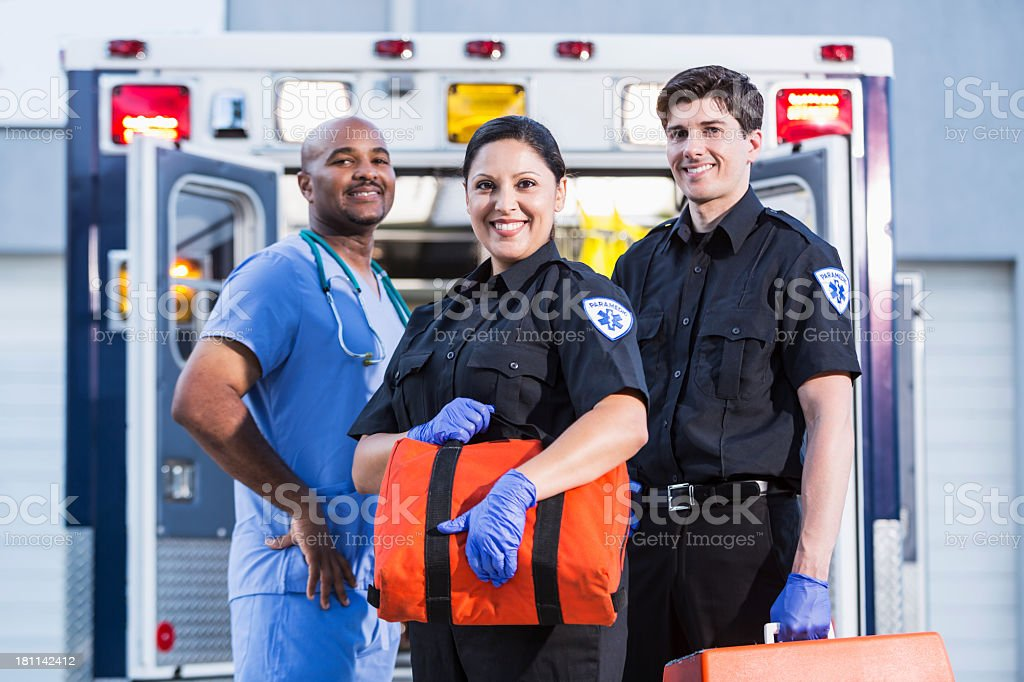 Paramedics and doctor outside ambulance stock photo
