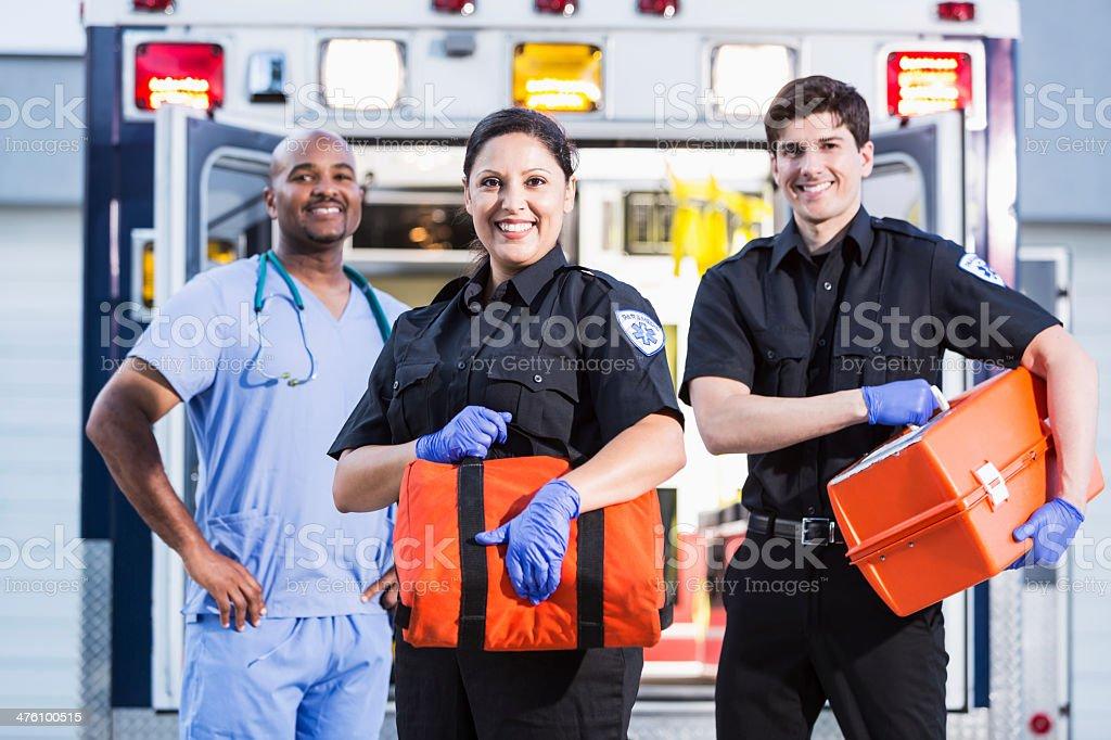 Paramedics and doctor outside ambulance stock photo