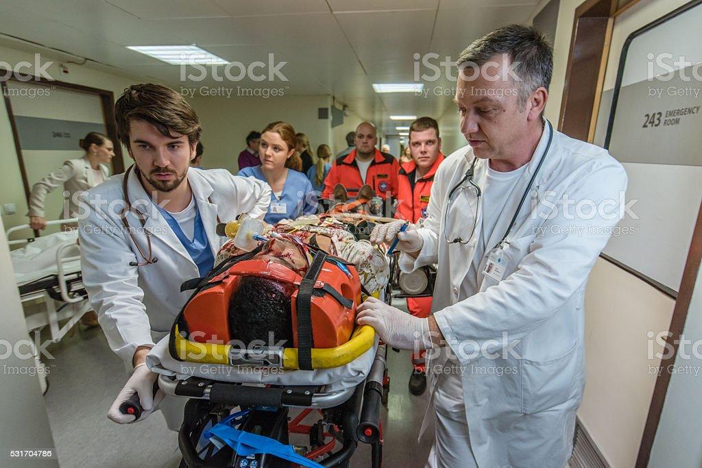 Paramedics and doctors in hospital stock photo