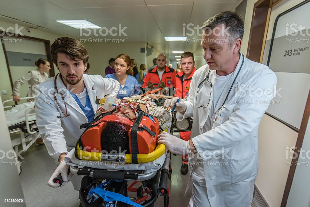 Paramedics and doctors in hospital stock photo