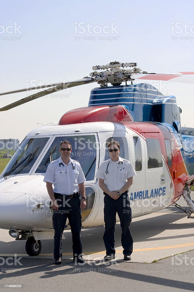 Paramedics and Medivac Helicopter stock photo