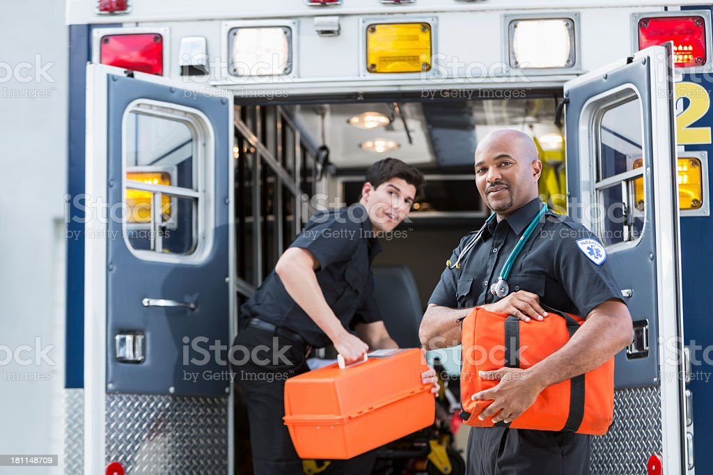 Paramedics at back of ambulance stock photo