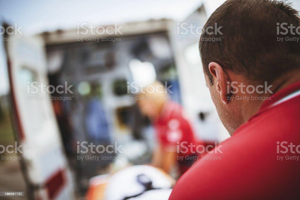paramedics bring the stretcher inside ambulance royalty-free stock photo