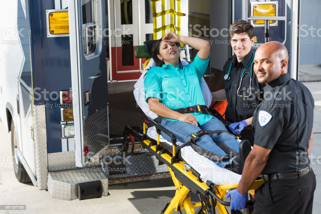 Paramedics helping a patient royalty-free stock photo