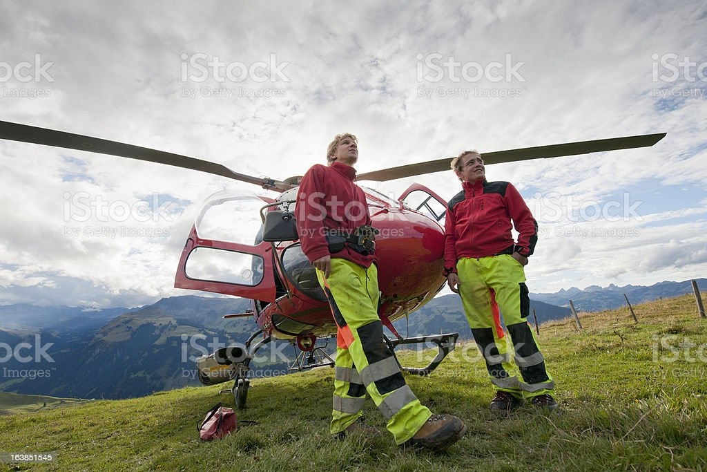 paramedics in front of rescue helicopter stock photo