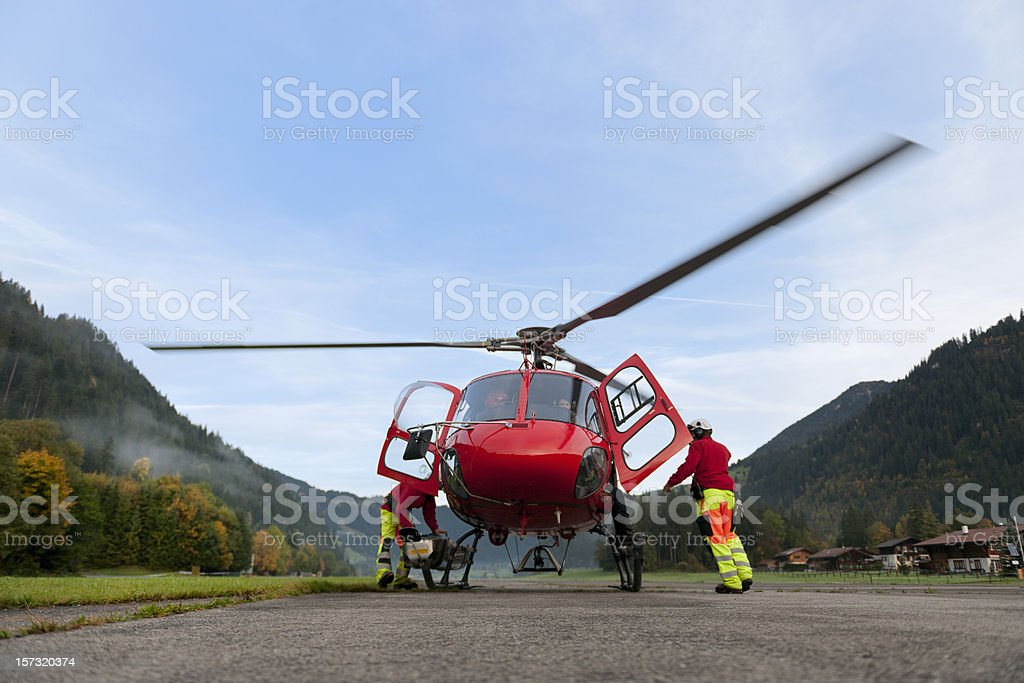 paramedics preparing rescue helicopter for take off stock photo
