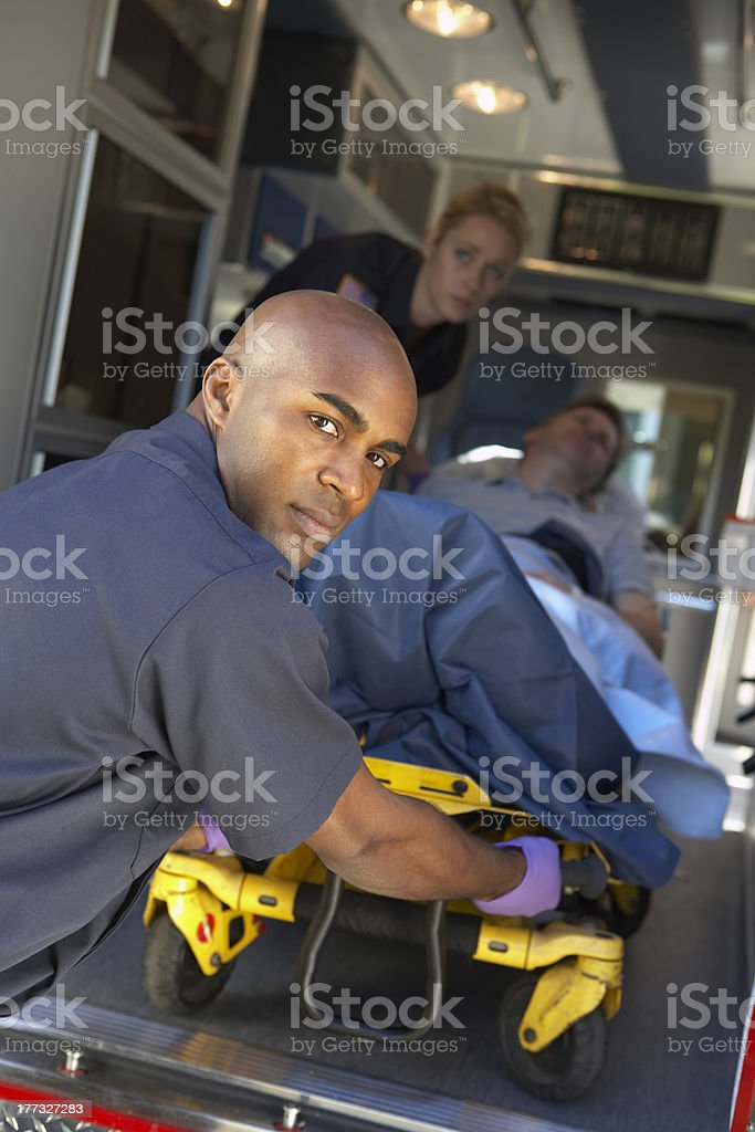 Paramedics preparing to unload patient on gurney stock photo