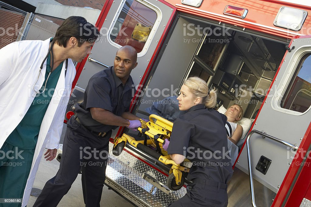 Paramedics unloading patient from ambulance stock photo