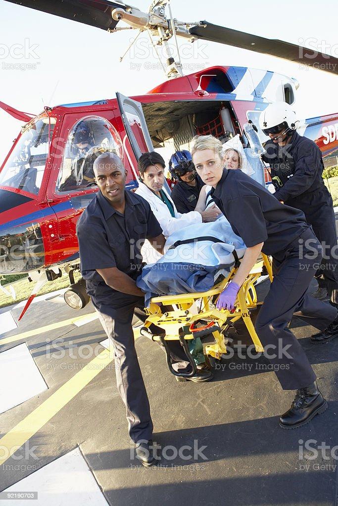 Paramedics unloading patient from Medevac stock photo