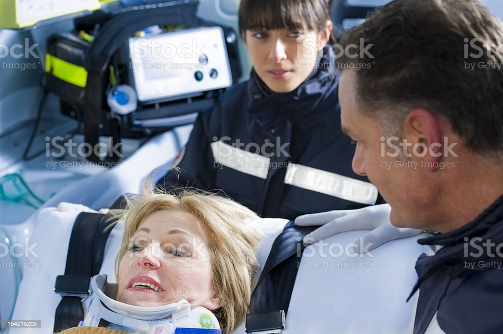 Paramedics with patient in neck brace royalty-free stock photo
