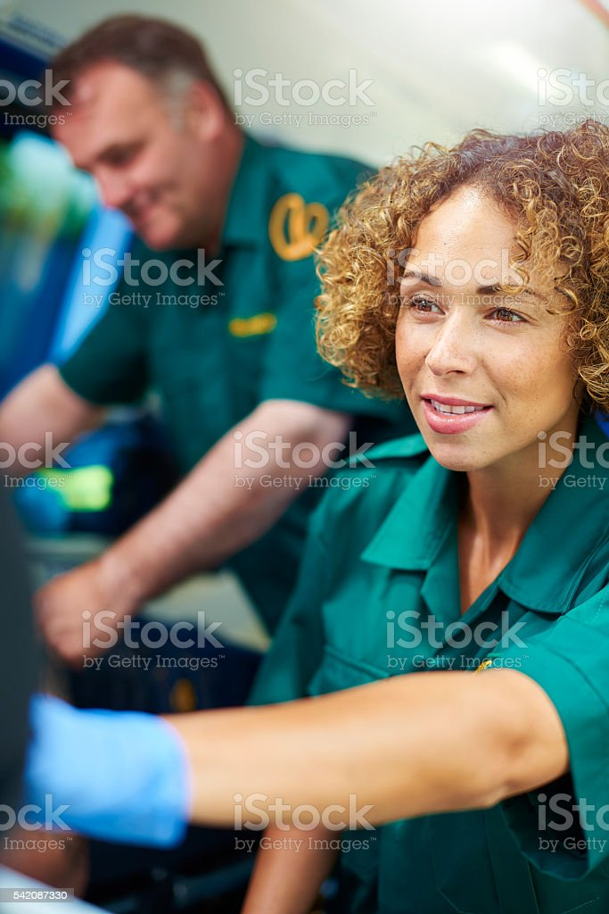 paramedics with patient stock photo
