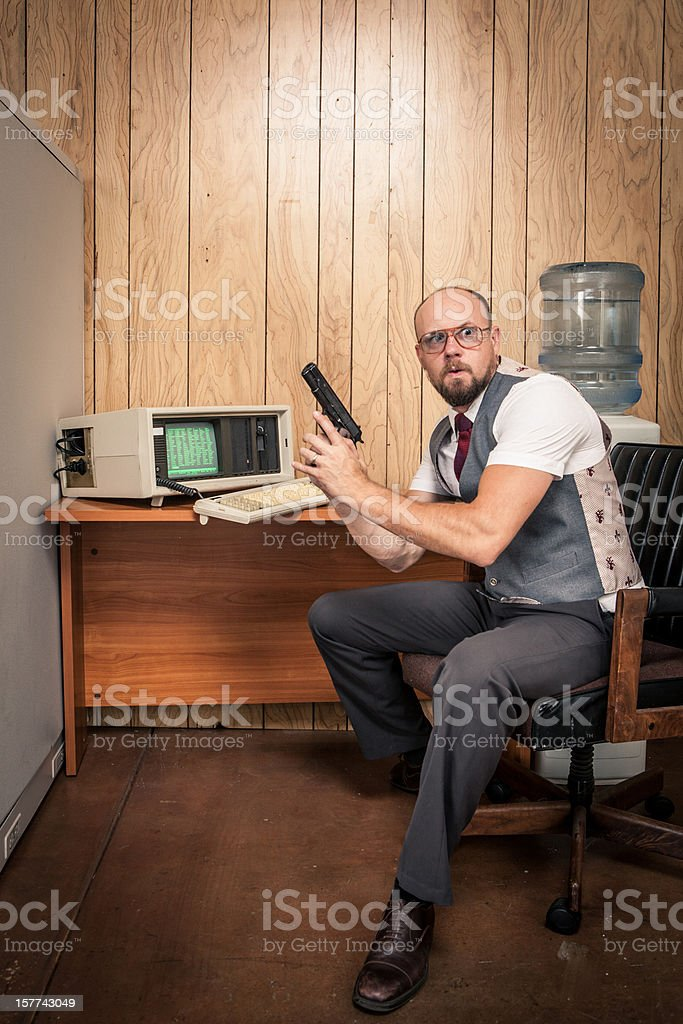 Paranoid gun weilding office worker 1980's computer style stock photo