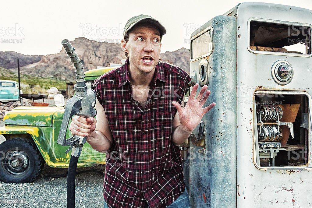 Paranoid Redneck Gas Station Attendant stock photo
