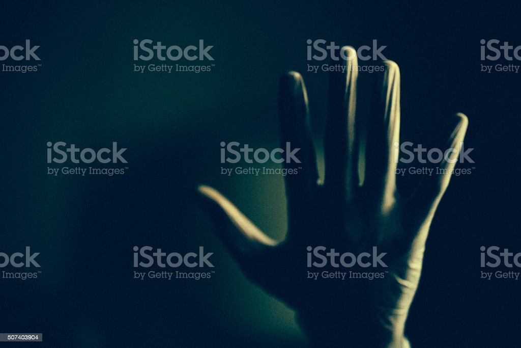 Paranormal hand in the dark background stock photo