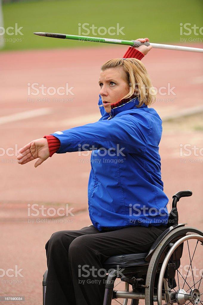 Paraplegic on wheelchair exercising javelin stock photo
