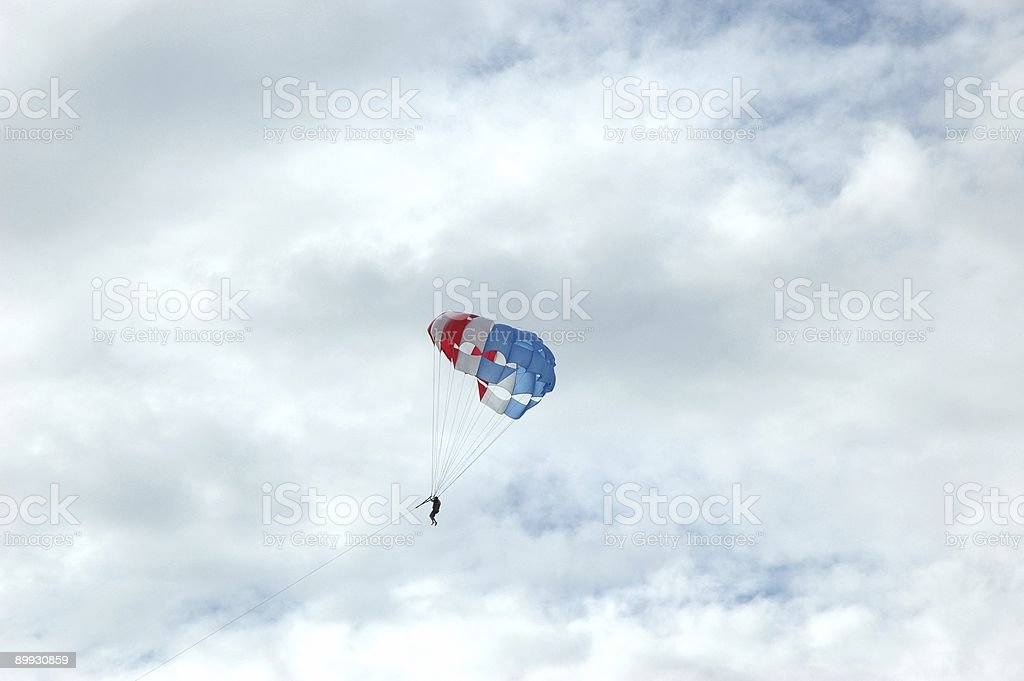 Parasailing against the blue sky royalty-free stock photo