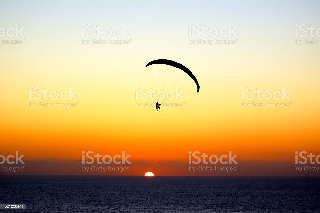 Parasailing at Torrey Pines at sunset. stock photo
