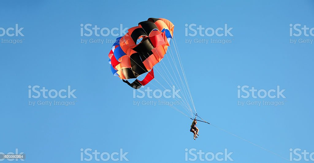 parasailing couple on vacation stock photo