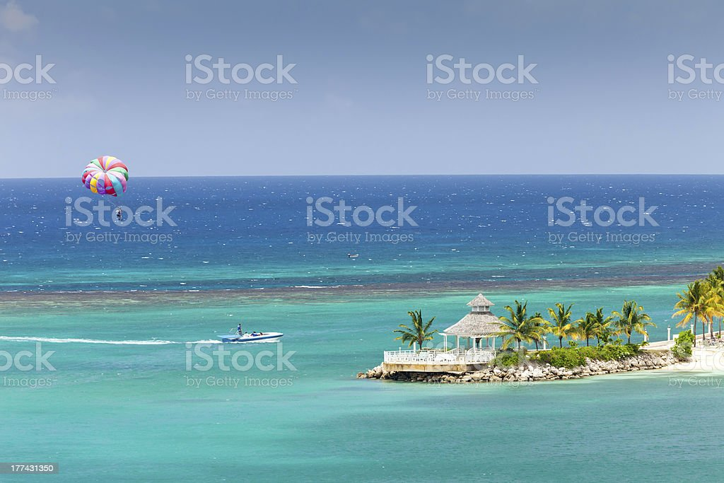Parasailing in Jamaica over gazebo stock photo