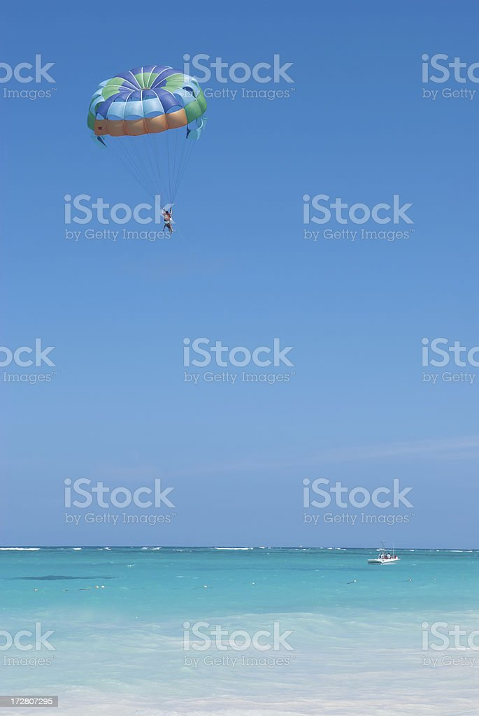 Parasailing into the Blue stock photo