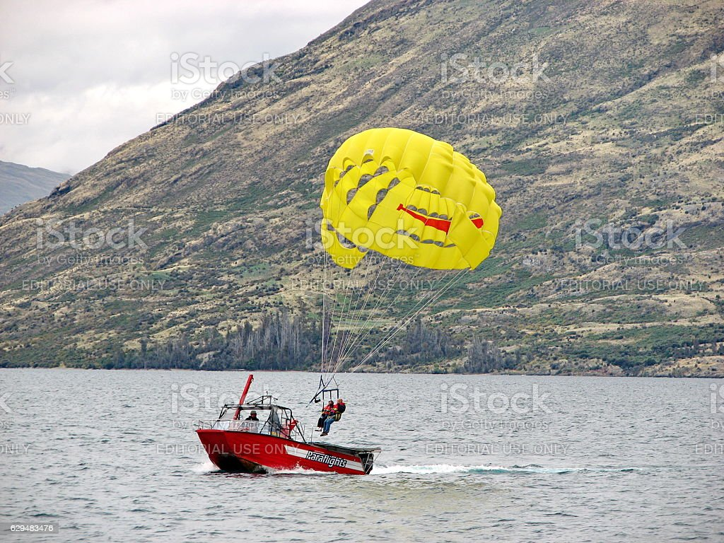 Para-sailing of 'Queenstown Paraflights Ltd' was landed to the boat. stock photo