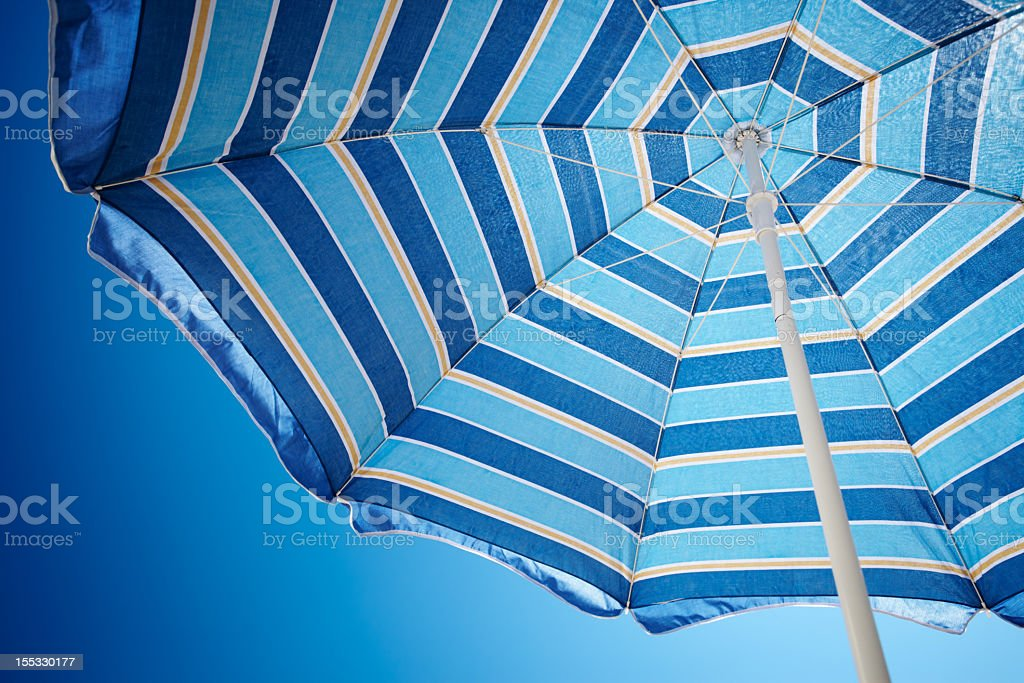 Parasol against deep blue sky royalty-free stock photo