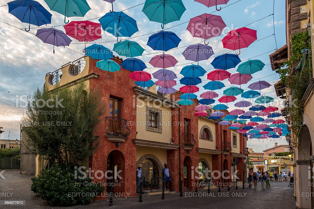Parasol hanging in Pula Old Town Street Sardegna Italy stock photo
