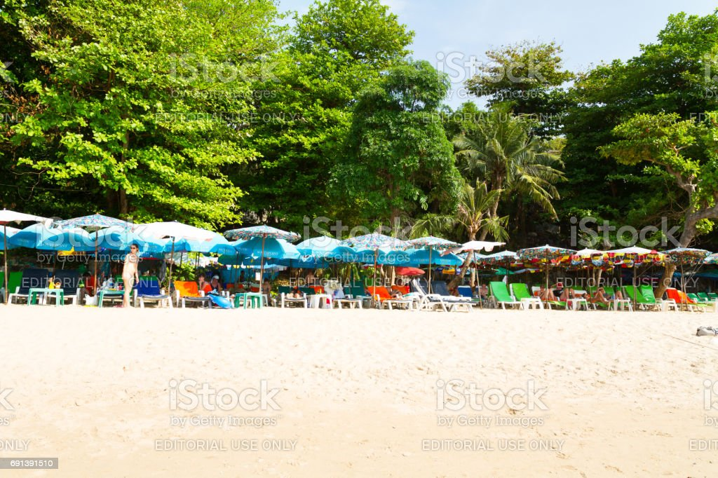 Parasols and tourists on Cozy beach Pattaya stock photo
