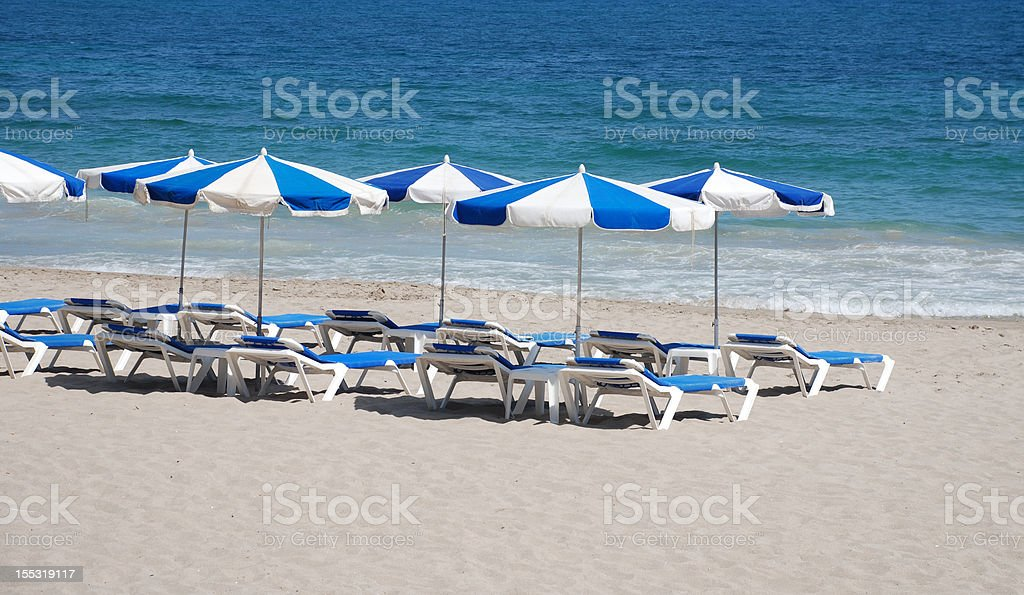 Parasols on the beach royalty-free stock photo