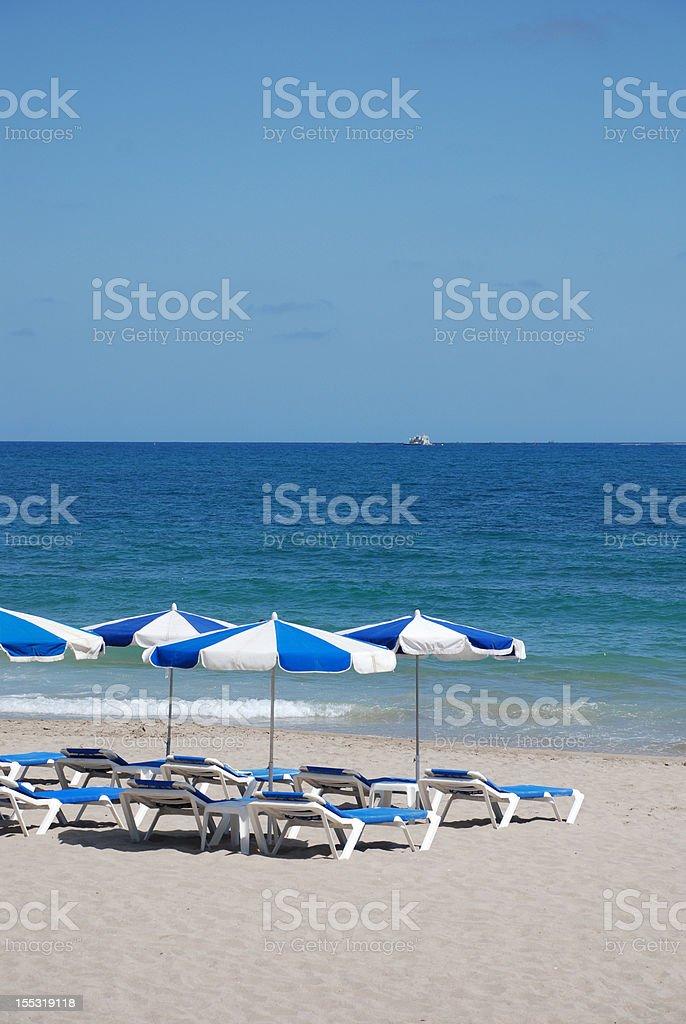 Parasols on the beach royalty-free stock photo