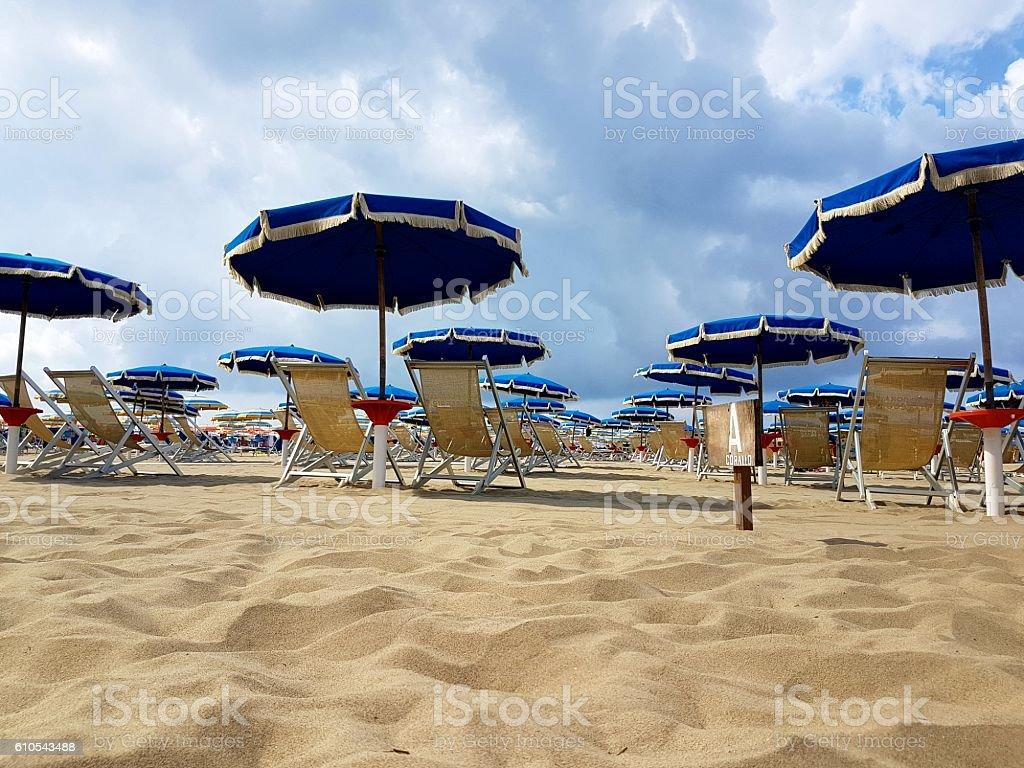 parasols on the sandy beach stock photo