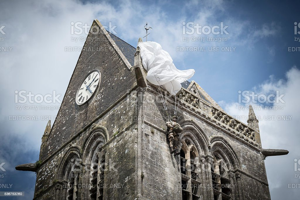 Paratrooper caught on Sainte-Mere-Eglise church, Normandy, France stock photo