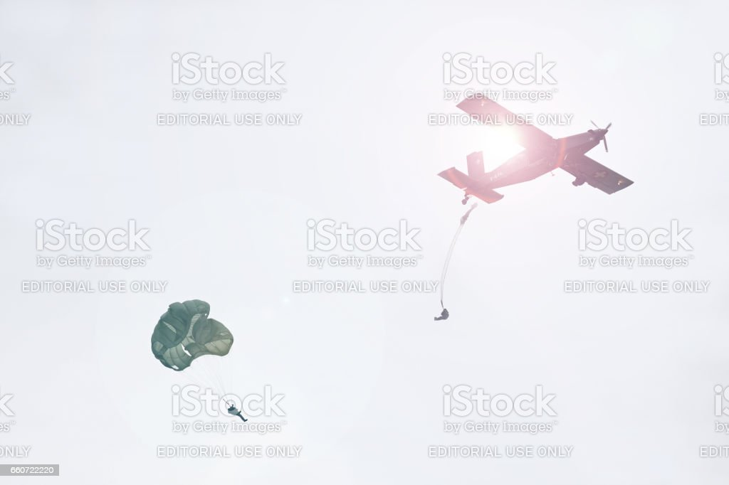 Paratroopers jumping off airplane stock photo