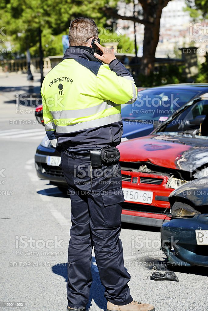 Parc Inspector on the phone reporting about burned cars,  Barcelona royalty-free stock photo
